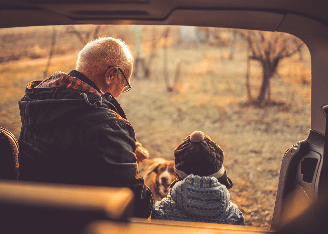 Old man and boy with a puppy